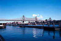 The Ed Koch-Queensboro Bridge over the East River, over Roosevelt Island, connecting Manhattan (L) with the Borough of Queens. (© Richard B. Levine)