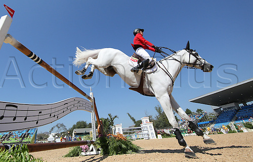 14.08.2016. Rio de Janeiro, Brazil. Meredith Michaels-Beerbaum of Germany on horse Fibonacci clears an obstacle during the Jumping Individual 1st Qualifier of the Equestrian competition at the Olympic Equestrian Centre during the Rio 2016 Olympic Games in Rio de Janeiro, Brazil, 14 August 2016.