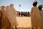 Darfuri children sing in their 800 capacity school in Klaimendo village in North Darfur, 04 Dec, 2008. Despite the fact that North Darfur is believed to currently have the highest concentration of NGOs in the world, the creation of Klaimendo district and village is the work of people born and raised in the area, rather than an outside aid agency. (John D McHugh)