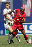 July 24, 2005: East Rutherford, NJ, USA:  USMNT defender Greg Vanney (3) and Panama's Alberto Blanco (8) collide during the CONCACAF Gold Cup Finals at Giants Stadium.  The USMNT won 3-1 on penalty kicks.