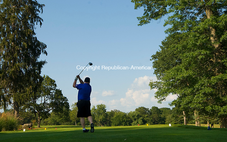 SOUTHBURY, CT-0731117JS02-- Scott Kellogg, Chief of Harwinton Westside Volunteer Fire Department, tees off during a memorial golf tournament Monday at Heritage Village Country Club in Southbury. <br /> Jim Shannon Republican-American