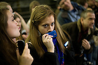 People wait to catch a glimpse of Mitt Romney at a Romney campaign event to begin at Gilchrist Metal Fabricating in Hudson, New Hampshire, on Jan. 9, 2012.  Romney is seeking the 2012 Republican presidential nomination.