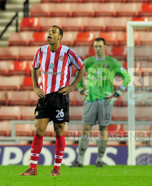 Sunderland's Anton Ferdinand and Marton Fulop look dejected as they concede a late penalty.