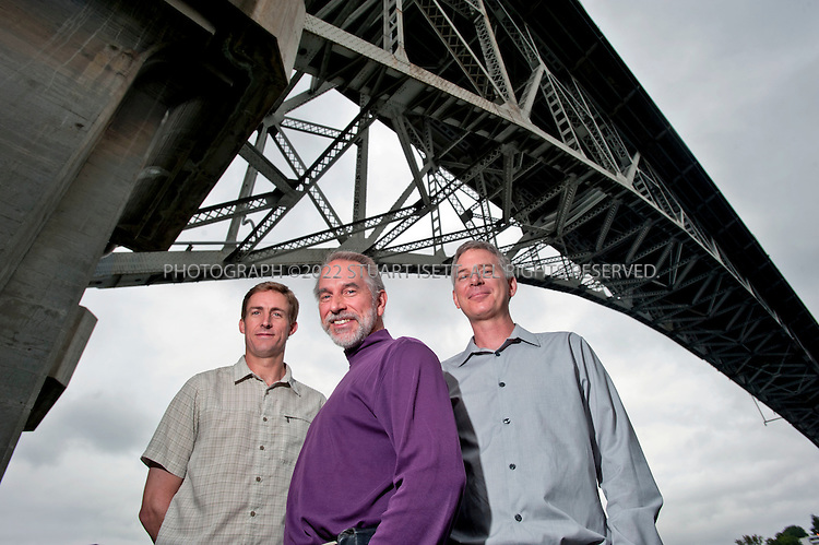 6/17/2010--Seattle, WA, USA..Aaron Sheedy (left), Cliff Kushler and Mike McSherry (right) pose under the Aurora Bridge in Seattle's Fremont district where Swype's office is located...Cliff Kushler, original inventor of predictive texting technology, has created a new method of inputting text on a touchscreen by dragging a finger across a touch keyboard called Swype. Here he demonstrates the software on a Samsung smart phone.He hopes it will become the default way to type on a touchscreen. By the end of this year, 10 million devices on all four US carriers are slated to have the Swype technology and the company is expanding to Asia, Europe and South America. ..Here Kushler poses under the Aurora Bridge in Seattle Fremont district where Swype's office is located....©2010 Stuart Isett. All rights reserved.