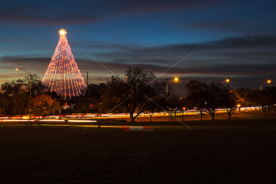 Beautiful sunset greets the the Zilker Holiday Tree on display in Austin at Zilker Park. The lighting of the Zilker Holiday Tree brings the Christmas sprit in Austin, Texas.