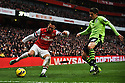 Santi Cazorla of Arsenal vies for ball with a player of Aston Villa during the English Premier League soccer match between Arsenal and Aston Villa at the Emirates Stadium, London, Britain, on 23 February 2013.THOMAS CAMPEAN/Pixel8000 Ltd...
