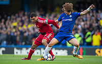 Troy Deeney of Watford battles David Luiz of Chelsea during the Premier League match between Chelsea and Watford at Stamford Bridge, London, England on 21 October 2017. Photo by Andy Rowland.