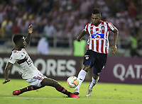 BARRANQUILLA, COLOMBIA - MARCH 04: Miguel Borja of Junior fights for the ball during a group A match of Copa CONMEBOL Libertadores between Junior and Flamengo at Estadio Metropolitano on March 4, 2020 in Barranquilla, Colombia. (Photo by Daniel Munoz/VIEW press via Getty Images)