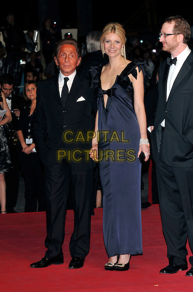 "VALENTINO & GWYNETH PALTROW .""Two Lovers"" arrivals at Palais de Festival during the 61st Cannes International  Film Festival,.France, 19th May 2008 .red carpet full length navy blue bow ruffle shoulders low cut dress plunging neckline suit tie designer holding hands heels shoes buckles.CAP/PL.© Phil Loftus/Capital Pictures"