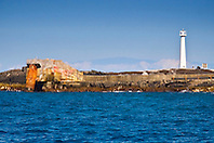 "Lighthouse, deep seawater supply pipe of NELHA (National Energy Laboratory of Hawaii Authority), and Haleakala volcanic mountain of Maui in the background, Keahole Point, the 1m (40"") in diameter, 6,284 foot long pipeline caters 6ºC (43ºF) cold deep seawater from 2,000-foot depths to over 30 thriving enterprises in the industrial park, off Kona Coast, Big Island, Hawaii, Pacific Ocean."