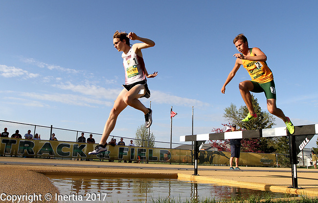 FARGO, ND - MAY 12: Robert Murphy from IUPUI  and Brant Gilbertson from North Dakota State clear the water during the men's steeple chase at the 2017 Summit League Outdoor Championship Friday afternoon at Ellig Sports Complex in Fargo, ND. (Photo by Dave Eggen/Inertia)