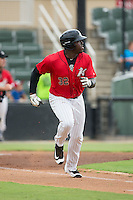 KJ Woods (32) of the Kannapolis Intimidators hustles down the first base line against the against the Charleston RiverDogs at Kannapolis Intimidators Stadium on August 3, 2016 in Kannapolis, North Carolina.  The Intimidators defeated the RiverDogs 8-4.  (Brian Westerholt/Four Seam Images)
