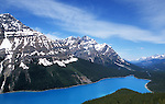 The turquoise Peyto lake and Mount Jimmy Simpson are seen on a bright sunny day in Alberta Canada.