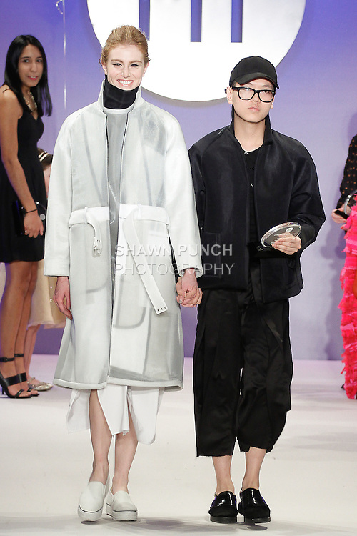 Student fashion designer Peter Do wins a Sportswear Critic Award and walks runway with model, during the FIT Future of Fashion 2014 Graduates' Collection fashion show, at the Fashion Institute of Technology on May 1, 2014.