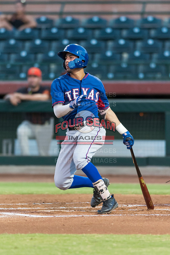 AZL Rangers shortstop Jonathan Ornelas (10) follows through on his swing during an Arizona League game against the AZL Giants Black at Scottsdale Stadium on August 4, 2018 in Scottsdale, Arizona. The AZL Giants Black defeated the AZL Rangers by a score of 6-3 in the second game of a doubleheader. (Zachary Lucy/Four Seam Images)