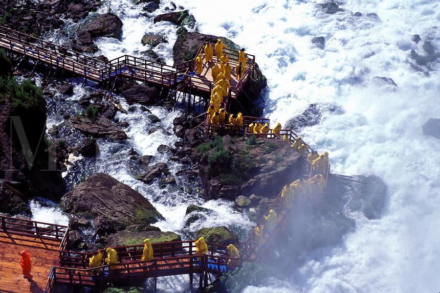 Niagara Falls, NY, New York, Tour group wearing raincoats at the base of Bridal Veil Falls, Cave of the Winds.
