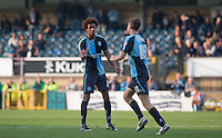 Sido Jombati of Wycombe Wanderers congratulates goal scorer Dan Rowe of Wycombe Wanderers during the Sky Bet League 2 match between Wycombe Wanderers and Northampton Town at Adams Park, High Wycombe, England on 3 October 2015. Photo by Andy Rowland.