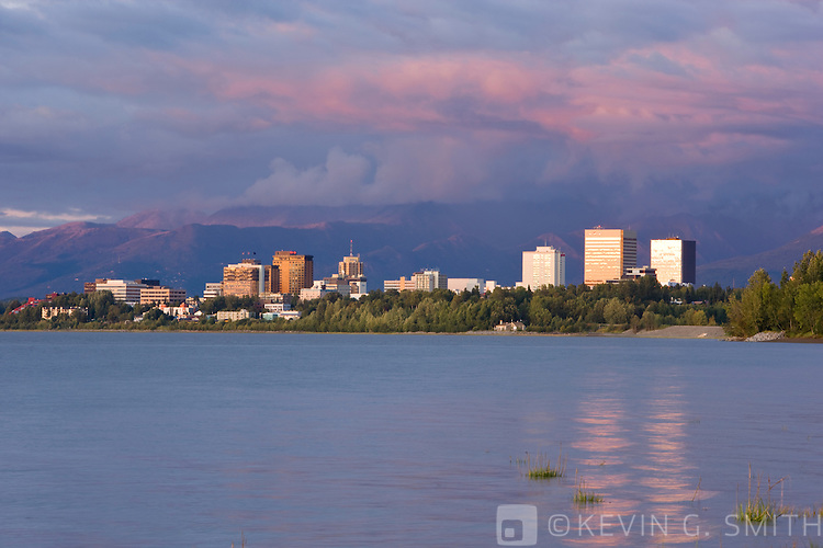 The Anchorage Skyline at sunset, taken from the Tony Knowles Coastal Trail, High tide, Late summer, Anchorage, Southcentral Alaska, USA.