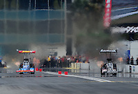 Mar. 11, 2012; Gainesville, FL, USA; NHRA top fuel dragster driver T.J. Zizzo (left) races alongside Shawn Langdon during the Gatornationals at Auto Plus Raceway at Gainesville. Mandatory Credit: Mark J. Rebilas-