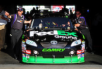 Oct. 9, 2009; Fontana, CA, USA; The car of NASCAR Sprint Cup Series driver Denny Hamlin is pushed through tech inspection during qualifying for the Pepsi 500 at Auto Club Speedway. Mandatory Credit: Mark J. Rebilas-