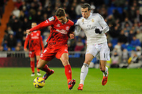 Real Madrid´s Gareth Bale and Sevilla's Grzegorz Krychowiak during 2014-15 La Liga match between Real Madrid and Sevilla at Santiago Bernabeu stadium in Alcorcon, Madrid, Spain. February 04, 2015. (ALTERPHOTOS/Luis Fernandez) /NORTEphoto.com