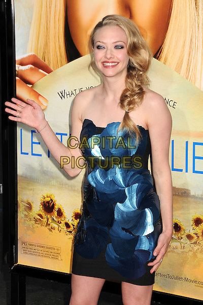 "AMANDA SEYFRIED.Attending ""Letters To Juliet"" Los Angeles Premiere held at Grauman's Chinese Theatre, Hollywood, California , USA, .11th May 2010..arrivals half length  side fishtail plaid braid strapless blue dress black applique textured texture pleated fans hand waving smiling white rosettes  .CAP/ADM/BP.©Byron Purvis/AdMedia/Capital Pictures."