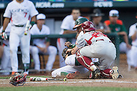 Miami Hurricanes outfielder Ricky Eusebio (2) slides at home as Arkansas Razorbacks catcher Carson Shaddy (28) tags him during the NCAA College baseball World Series the  on June 15, 2015 at TD Ameritrade Park in Omaha, Nebraska. Miami beat Arkansas 4-3. (Andrew Woolley/Four Seam Images)