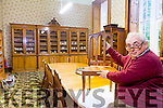Denis Lynes of Lynes & Lynes Auctions looking over the many items of Furniture up for Auction at the Sisters of Mercy. St John's Mercy Convent, Balloonagh