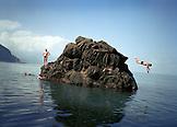 REPUBLIC OF GEORGIA, man jumping from a large rock into the Black Sea, Batumi