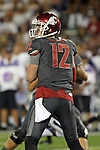 Connor Halliday looks down field for an open receiver during the Washington State Cougars non-conference road opener against the Nevada Wolfpack at Mackay Stadium in Reno, Nevada, on September 5, 2014.