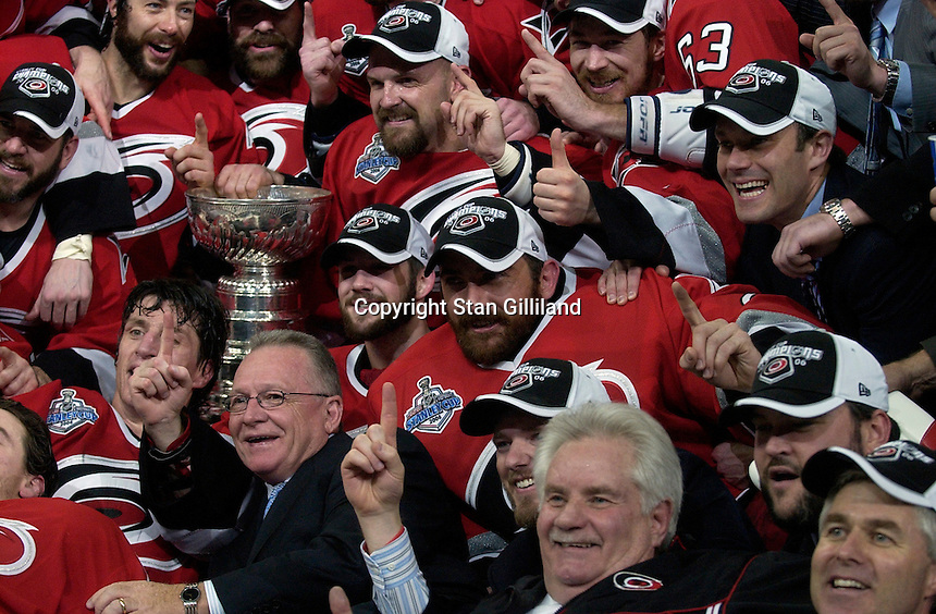 GM Jim Rutherford, below Cup, gets in the middle of the post game team photo. The Carolina Hurricanes beat the Edmonton Oilers 3-1 in game seven to take the Stanley Cup at the RBC Center in Raleigh, NC Monday, June 19, 2006.