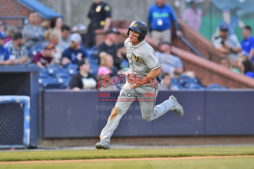 West Virginia Power center fielder Jarred Kelenic (10) runs home during a game against the Asheville Tourists at McCormick Field on April 18, 2019 in Asheville, North Carolina. The Power defeated the Tourists 12-7. (Tony Farlow/Four Seam Images)