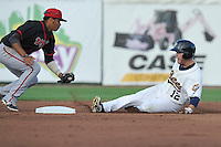 Center fielder Tyler Palmer #12 of the Burlington Bees slides safely into second base against the Lansing Lugnuts at Community Field on July 28, 2014 in Burlington, Iowa. The Lugnuts won 9-2.   (Dennis Hubbard/Four Seam Images)