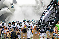 Todd Herremans leads the team onto the field before a game against the Washington Redskins at Lincoln Financial Field on September 21, 2014 in Philadelphia, Pennsylvania. The Eagles won 37-34. (Photo by Hunter Martin/Philadelphia Eagles