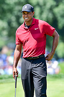 Bethesda, MD - July 1, 2018: Tiger Woods smiles after hitting  a nice shot on the 7th hole during final round of professional play at the Quicken Loans National Tournament at TPC Potomac at Avenel Farm in Bethesda, MD.  (Photo by Phillip Peters/Media Images International)