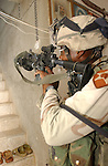Pfc. Charles Barnes, from Saint Louis, Mo., secures a stairwell in a home in Tall Afar, Iraq, during Operation Sykes Hammer on Aug. 1, 2004. Three battalions from the 3rd Brigade, 2nd Infantry Division (Stryker Brigade Combat Team) and three Iraqi National Guard battalions conducted Sykes Hammer in an effort to seize weapons and detain anti-Iraqi forces. Barnes is a member of Company B, 5th Battalion, 20th Infantry Regiment. (U.S. Army photo by Sgt. Fred Minnick)
