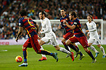 Real Madrid´s Gareth Bale (C) and Barcelona´s Sergi Roberto and Sergio Busquets during 2015-16 La Liga match between Real Madrid and Barcelona at Santiago Bernabeu stadium in Madrid, Spain. November 21, 2015. (ALTERPHOTOS/Victor Blanco)