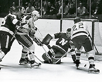 Seals #18 Gary Croteau and #22 Dennis Hextall try to jam the puck past NorthStar goalie Gump Worsley..1971 photo by Ron Riesterer