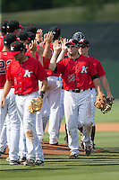 Ryan Leonards (13) of the Kannapolis Intimidators celebrates with teammates after their victory over the Lakewood BlueClaws at CMC-Northeast Stadium on May 17, 2015 in Kannapolis, North Carolina.  The Intimidators defeated the BlueClaws 4-1.  (Brian Westerholt/Four Seam Images)