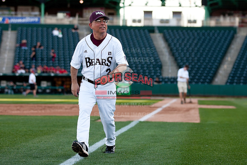 Head Coach Keith Guttin (2) of the Missouri state Bears runs out to the team's pregame meeting prior to a game against the Purdue Boilermakers at Hammons Field on March 13, 2012 in Springfield, Missouri. (David Welker / Four Seam Images).