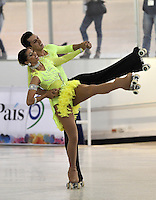 CALI – COLOMBIA – 19 – 09 – 2015: Leonardo Parrado y Marcela Cuz, deportistas de Colombia, durante la prueba de Pareja Danzas Obligatorias Mayores en el LX Campeonato Mundial de Patinaje Artistico, en el Velodromo Alcides Nieto Patiño de la ciudad de Cali. / Leonardo Parrado and Marcela Cuz, participants from Colombia, during the Compulsory Couples Dance Senior test, in the LX World Championships  Figure Skating, at the Alcides Nieto Patiño Velodrome in Cali City. Photo: VizzorImage / Luis Ramirez / Staff.