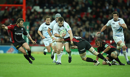 16.10.2010 Cian Healy of Leinster is tackled by Andy Saull of Saracens during the Heineken Cup Rugby match Saracens v Leinster at Wembley Stadium in London.