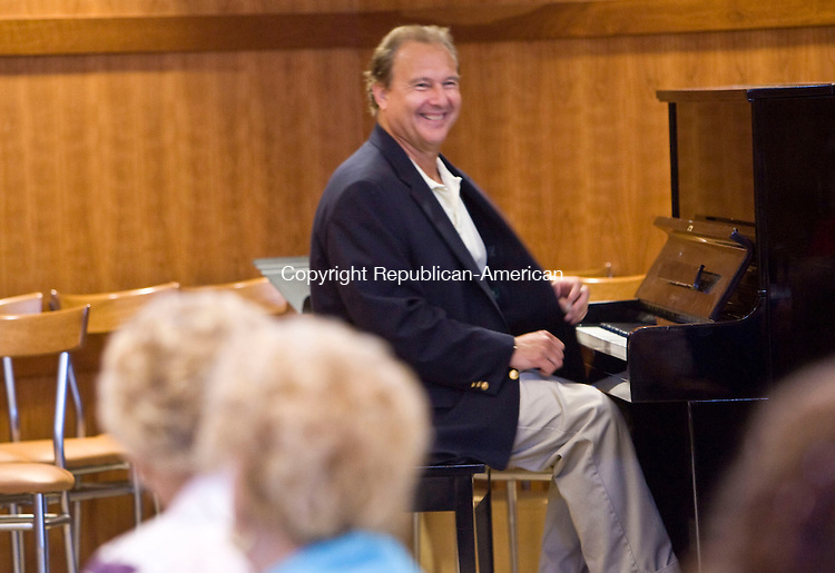 SOUTHBURY, CT - 01 JUNE 2010 -060110JT17-<br /> Pianist Roger Young of Litchfield performs for attendants of Tuesday's Love &amp; Knishes program at the Jewish Federation in Southbury.<br /> Josalee Thrift Republican-American