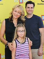 SANTA MONICA, CA, USA - NOVEMBER 16: Megyn Price, Grace Price, Edward Cotner arrives at the P.S. ARTS Express Yourself 2014 held at The Barker Hanger on November 16, 2014 in Santa Monica, California, United States. (Photo by Celebrity Monitor)