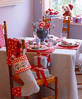 A table laid for Christmas with a large candy jar as a centrepiece