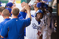 Oklahoma City Dodgers Yasiel Puig (46) celebrates in the dugout after hitting a home run in a game against the El Paso Chihuahuas at Chickasaw Bricktown Ballpark on August 12, 2016 in Oklahoma City, Oklahoma. Oklahoma City defeated El Paso 8-4.  (William Purnell/Four Seam Images)