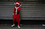A man dressed as santa claus speak on phone as he take part during the SantaCon party in New York, United States. 15/12/2012. Photo by Kena Betancur/VIEWpress.
