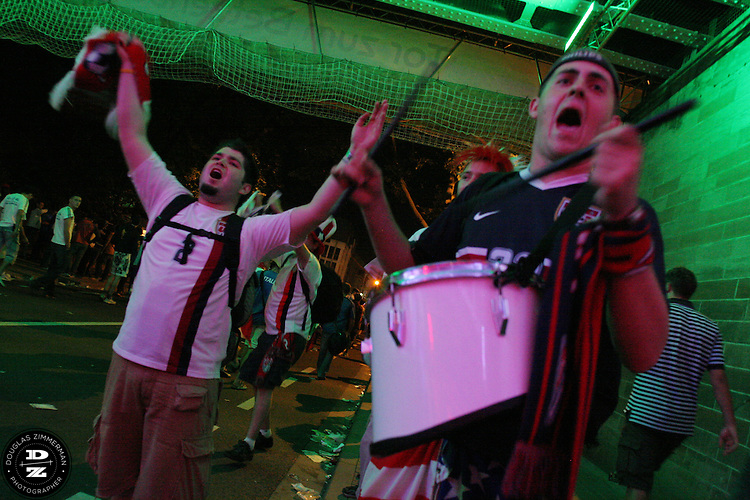 USA National Soccer Team fans celebrate the USA's 1-1 draw with Italy just outside the stadium in Kaiserslautern Germany  on Saturday June 17th, 2006 in Kaiserslautern, Germany.