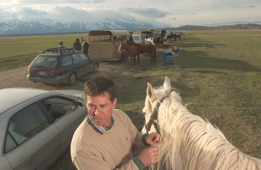 Ben Bartlett, of Jackson, Wyo., cleans a horse's mane while waiting in line at teh National Elk Refuge Wednesday, April 30, 2003. Hundreds of antler seekers waited for up to 24 hours to enter a national forest near Jackson, Wyo., to collect shed elk antlers. Many sell the antlers for eastern medecine. Others use them for rustic furniture.