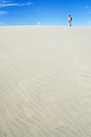 Girl walking on dunes, Farewell Spit, New Zealand